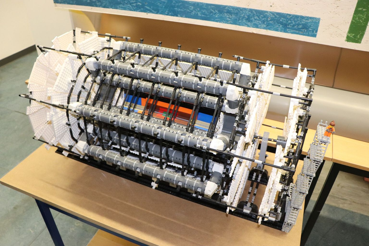 In the laboratory where Armin Fehr works, Lego bricks are used to reconstruct the ATLAS detector in miniature. With the detector the traces of the smallest particles can be detected at CERN. The red and green component inside the detector mark the location where the 'Inner Tracker' with the new Optoboards will be placed.