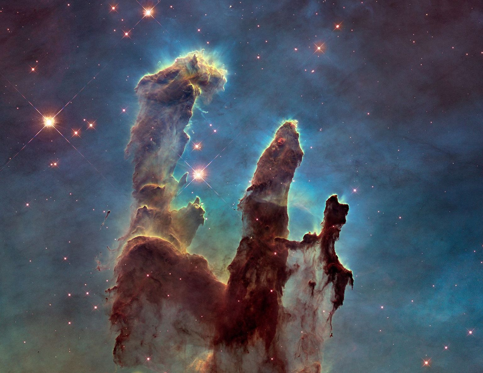 "Eagle Nebula's ""Pillars of Creation"". Credits: NASA/ESA/Hubble Heritage Team (STScI/AURA)/J. Hester, P. Scowen (Arizona State U.)"