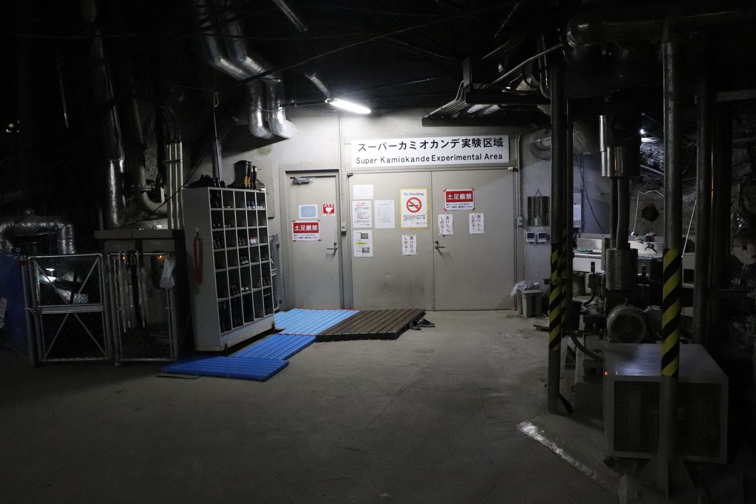 The entrance to the Super-Kamiokande detector. As always, when you enter a room in Japan, you have to take off your shoes (and stow them in the shelf on the left). Photo: B. Vogel