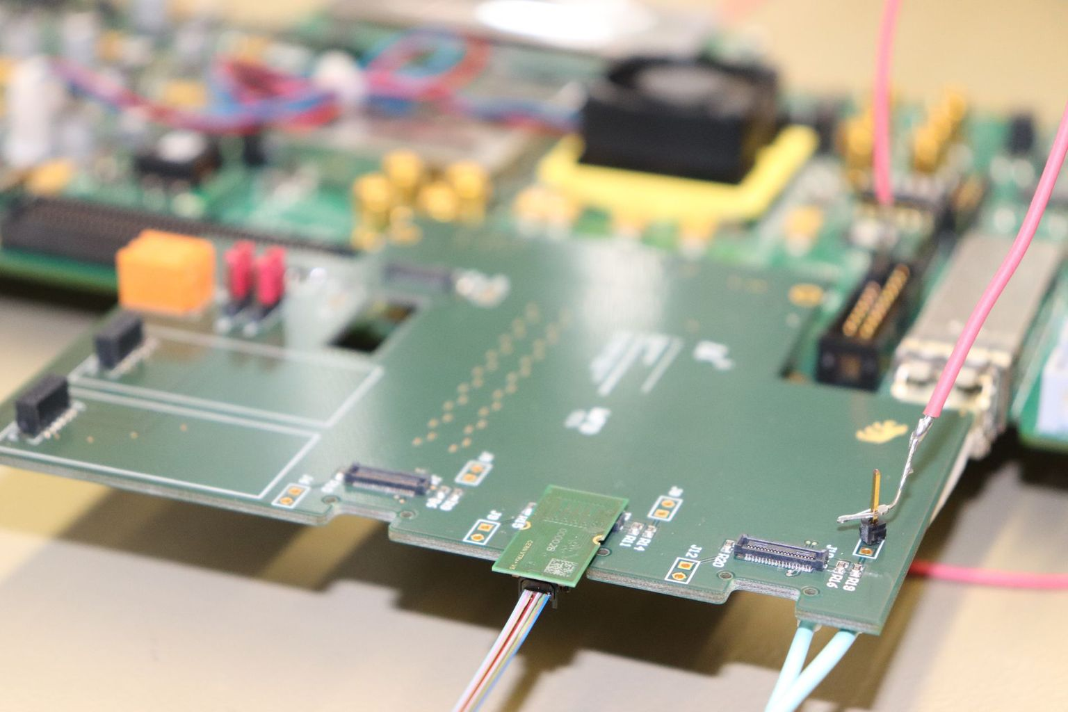 The printed circuit board used by Armin Fehr to study the conversion of electrical signals into light pulses. The fibre optic cables are connected in the foreground of the picture.