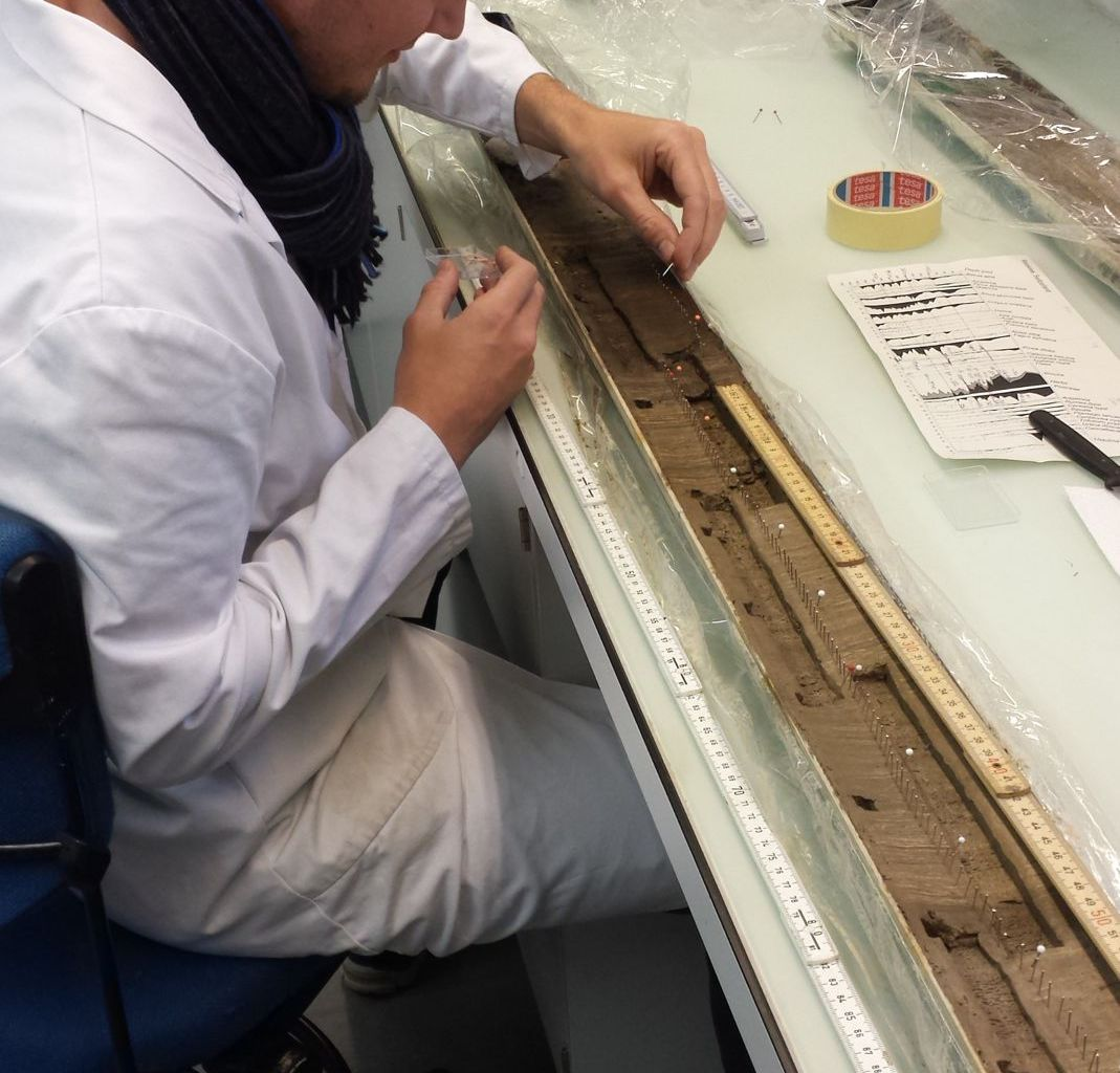 Preparing a sediment core section from Moossee for subsampling.