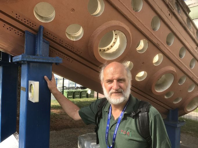 "Prof. Alain Blondel with the Gargamelle bubble chamber on the CERN site in Meyrin: With Gargamelle, ""neutral currents"" were discovered at CERN in 1973, a rare interaction between neutrinos and matter."